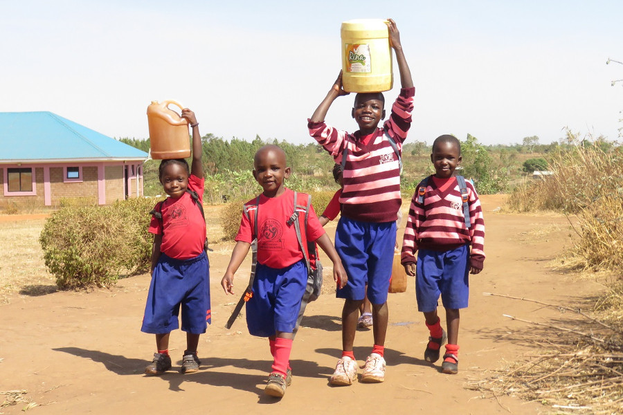 Carrying water in Uganda